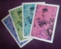 Packs of four greeting cards of painted abstract images of faeries in the forest