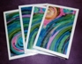 Packs of four greeting cards of painted images called Rainbow Spirals